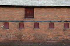 Old boarded up windows and doors in an old brick building Royalty Free Stock Photos