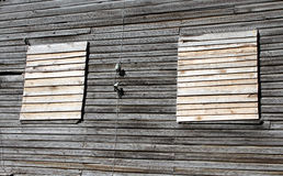 Old boarded window. Old windows with closed wooden planks stock images