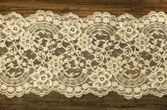Old boards covered with lace Stock Photography