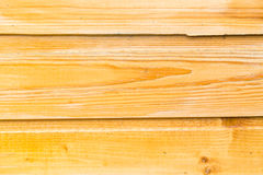 The old boards covered with a yellow varnish. Stock Photography