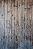 Old boards of gray-brown color with cracks. Royalty Free Stock Photos