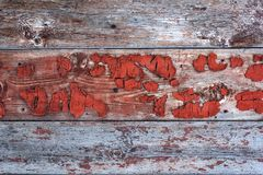Old boards with the remnants of red paint Royalty Free Stock Photo