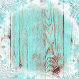 Old boards with snow and snowflakes. Background. Winter. Christm. Blue winter background. Old painted boards, frost and snowflakes. Christmas. New Year. Vintage Stock Photography
