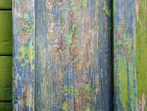 Old boards with traces of paint. It's a sheathing of the wooden hut in the central Russia Royalty Free Stock Photo