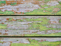 Old boards with traces of paint. It's a sheathing of the wooden hut in the central Russia Royalty Free Stock Image