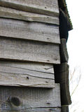 Old boards. Old wooden barn in cloudy weather royalty free stock photos