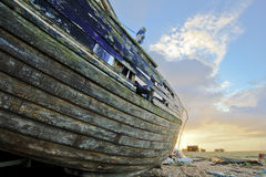 Old boat. Laying on land stock image