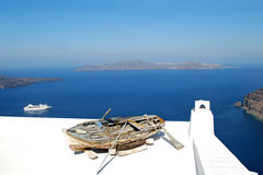 Old boat. Photo of old boat on the roof, Santorini Island, Greece Stock Image