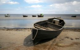 Old boat. Old fishermen boat at the beach Royalty Free Stock Image