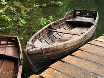 Old boat. Old wooden boat in water stock photo