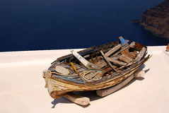 Old boat. The old boat on balcony at Santorini island, Greece royalty free stock photo