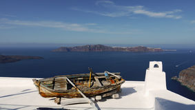 Old boat. Terrace with old boat and beautiful views of the sea. Santorini island, Greece stock image