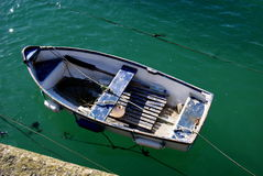 Boat in St Ives Bay, Cornwall. Old worn out boat on in the harbour of St Ives, Cornwall royalty free stock photos