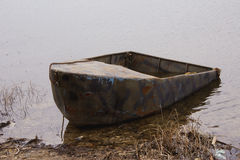 Old boat. Is on the spring river Royalty Free Stock Photography