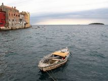 Old boat. Small port and old wooden boat in the city of Rovinj, Istria, Croatia Royalty Free Stock Photo