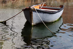 Old boat. An old wooden rowing boat tied-up Stock Photo