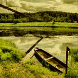 Old boat. Summer landscape with river, wooden bridge and old boat Stock Photos