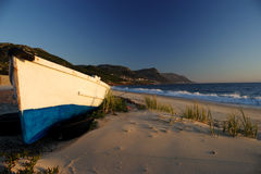 Old boat. A old wooden fishing boat on a sandy beach Royalty Free Stock Images