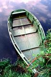 Old boat. Partially submerged old boat on the shore of the lake Stock Image