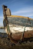 Old Boat. An old boat moored on the mud Royalty Free Stock Image