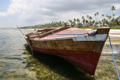 Old boat. Abandoned boat on the beach of Zanzibar Royalty Free Stock Photography