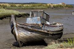 Old boat. Abandoned in the mud Stock Images