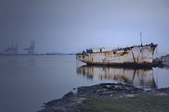An old boat. Aground on the coast stock photo