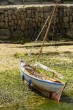 Old boat aground in Musehole harbour, Cornwall Stock Images