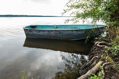 Old rusty boat on a riverside Stock Photos