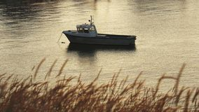 Old boat anchored in port on the river in the summer in evening. Old boat anchored in port on the river in the summer in the evening stock footage