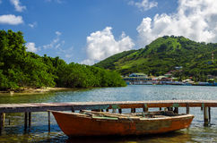 Old Boat And Tropical Island Royalty Free Stock Photos