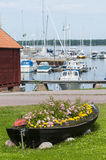 Old boat as flower container Royalty Free Stock Photo