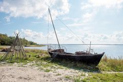 Old boat on the baltic shore royalty free stock images