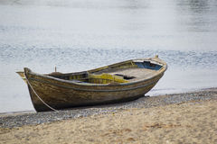 An old boat on the beach Royalty Free Stock Images