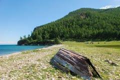 Old boat on the beach. Old boat on the baikal beach Royalty Free Stock Photos