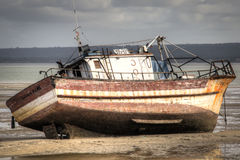 Old boat on the beach in Inhambane Royalty Free Stock Photo