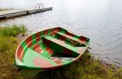 Old boat on beach in rain Stock Photo