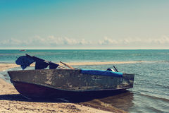 Old boat on the beach in a summer day Stock Photography