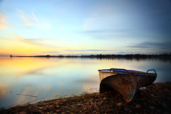 Old boat on the beach sunset landscape Royalty Free Stock Photos