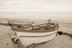 Old boat on the beach Royalty Free Stock Image