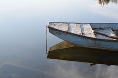 Old boat in calm water Stock Photo