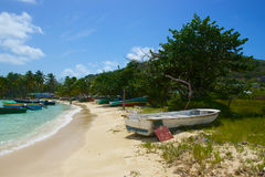 Old Boat on Caribbean Shore Stock Image