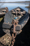 Old boat on the chain Royalty Free Stock Photography