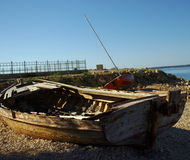 Old Boat On The Coast. Old Destroyed Boats On The Coast Royalty Free Stock Photo