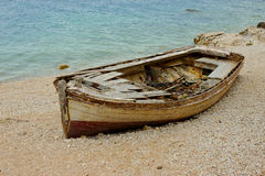 Old Boat On The Coast. Old Destroyed Boat on Seashore Royalty Free Stock Photos