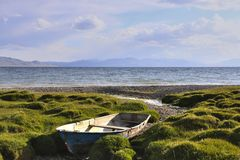 Old boat on the coast of Son-Kul. Lake, Naryn, Kyrgyzstan Stock Photo