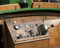 Old boat dashboard. Dashboard with controls in an old wooden boat stock photography