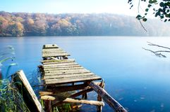 Old boat dock in the lake stock images