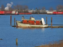 Old Boat. An old boat docked on the Fraser River stock photography