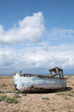 Old Boat at Dungeness, Kent, England. An abandoned boat at Dungeness, Kent, England Royalty Free Stock Photos